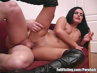 Ravishing brunette in leather boots pussy fisted