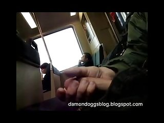 Jerking in front of passengers on train