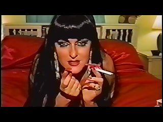 Vintage smoking fetish slut with long red nails lipstick takes a cumshot