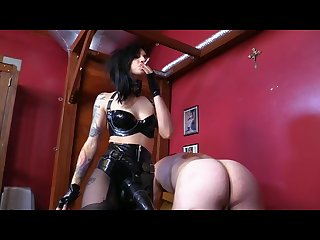 Smoking latex mistress fucks slave hard
