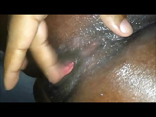 Fingering an ebony squirting vagina