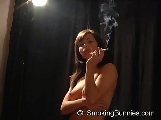 Topless smoking fetish girl