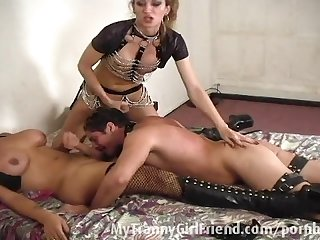 Guy dominated by two transsexuals