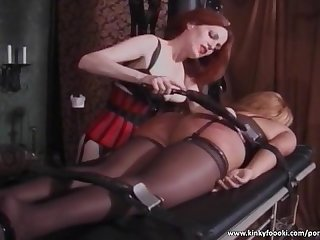 Stunning blonde milf spanked hard by nasty redhead