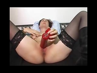 Mature pleasing with a red vibrator