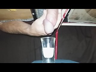 Milking a weeks worth of cum into a shotglass huge load
