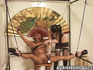 Japanese brunette tormented by a kinky mistress