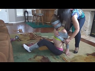 Girl duct tape mummified by girl