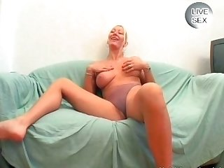 Blonde whore with huge tits sucks cock