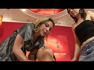 Two mistresses spit all over the slavegirls face