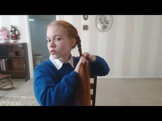Dolly braids her hair