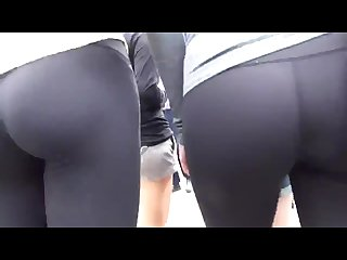 Candid sexy lesbians in tight leggings exposing their ass to street voyeurs