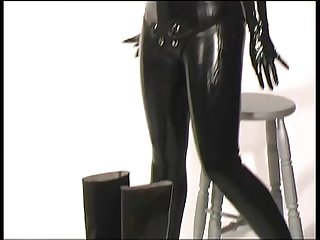 Dressing in beavertail wetsuit knee boots wearing black latex catsuit