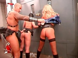 Bald masker has fun with two sexy sluts