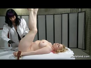 Slave girl gets a deep examination with sex toys from her lesbian doctor