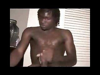 Handsome young black male jerking his big uncut cock