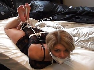 Hogtied on the bed