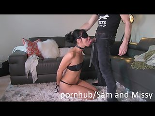 Dominant husband and submissive wife playing in front of camera