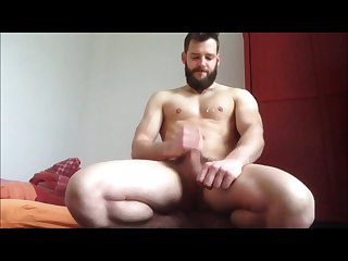 Hot bearded guy jerks off cums