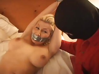 Tape gagged blindfolded bound