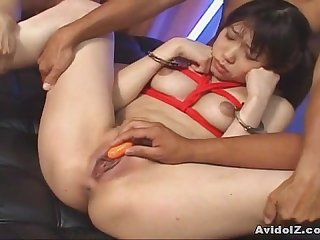 Japanese babe tied up and abused by a group uncensored