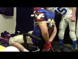 Two college bros in football gear tie each other up bound and gagged men
