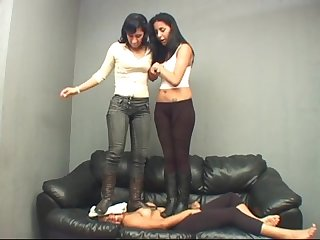 2 booted lesbian mistresses trample the tiny Slavegirl