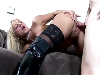 busty blonde milf having sex on a couch in boots and thigh high nylon