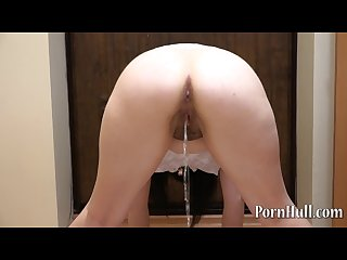 Natasha with hairy by a pussy pissing standing back view