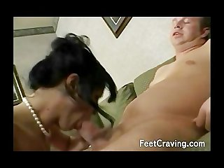 Milf uses her feet and wanks a big dong