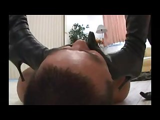 Two japanese girls in boots kicking a slave 2