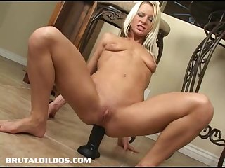 Petite blonde gaping her ass with a brutal dildo