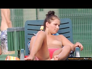 Sexy bikini teens tanning topless at the pool