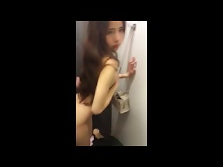 Amazing Chinese girl fucking her boyfriend in a changing room