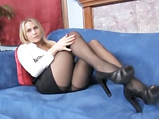 Big boobed blonde milf teases you with her sheer black pantyhose