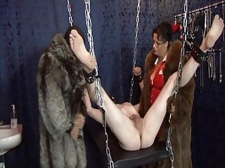 Mistress in fur dominates two guys