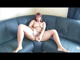 Redheaded cutie plays with both of her holes