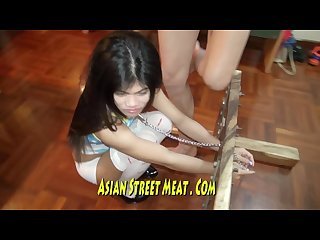 Little philipina in big wooden restraint