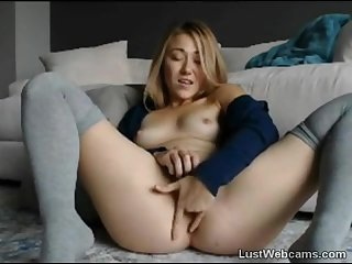 Cute blonde fingers her pussy on webcam