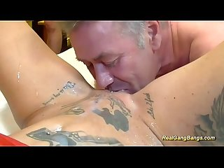 Busty tattooed german in wild gangbang