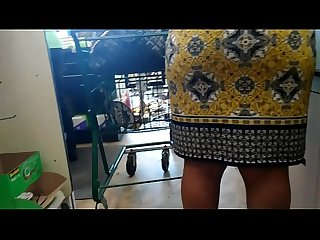 Old ebony grandmother milf booty in a skirt