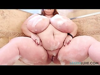 Ssbbw lexxxi luxe soaps up her huge hooters in shower