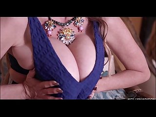 Sexy milf kelly madison shakes her huge boobs in a blue dress