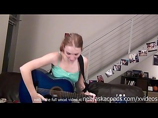 Naked guitar playing teen
