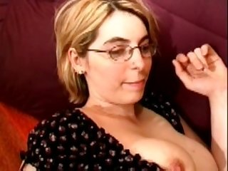 Fisting a blonde mature wearing glasses