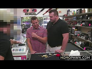 Firm muscle guy takes a double blowjob in the pawnshop for some cash