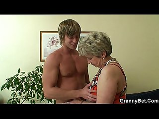 Lonely old grandma swallows and rides his cock