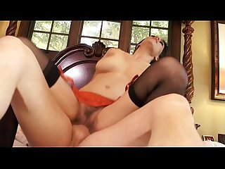 Cute brunette Raylene gets a hard cock thrust in her mouth hard on the bed