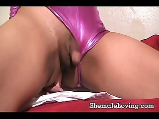 Horny shemale masturbating on the bed