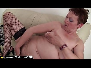 Horny busty older mom enjoys climaxing
